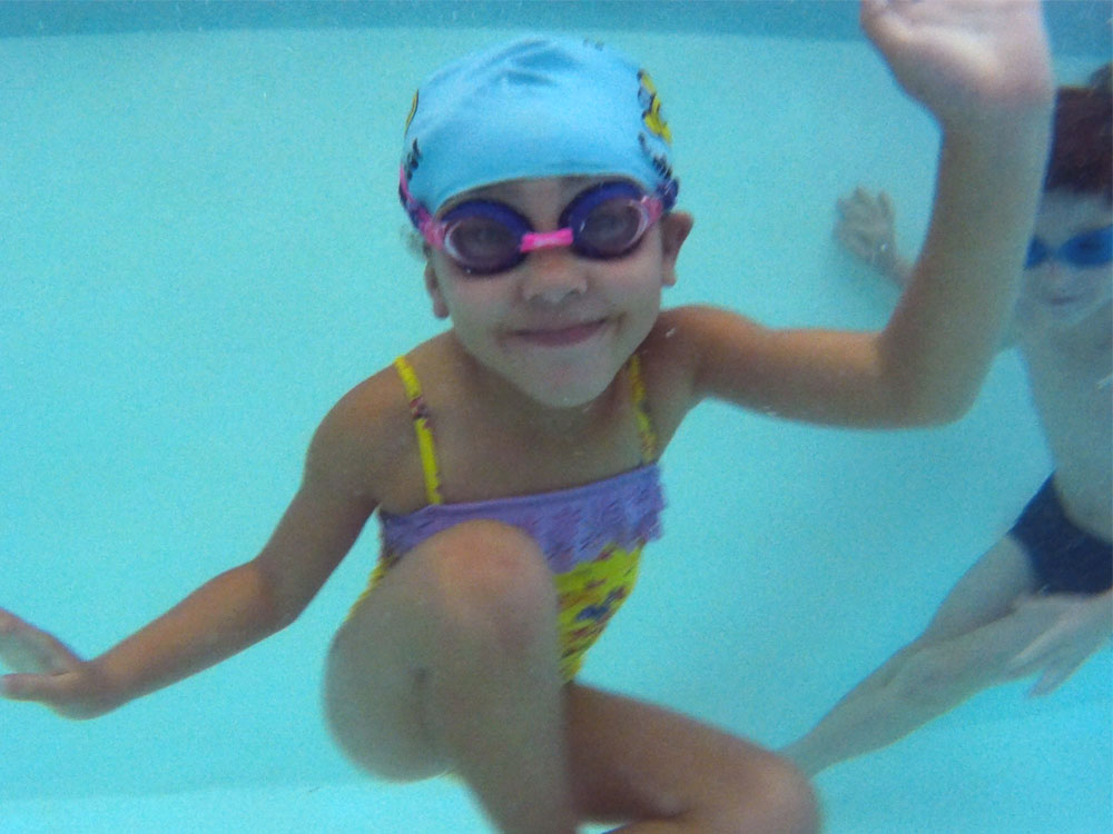 Girl underwater during swimming lesson