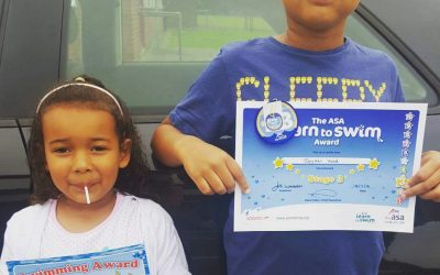 Jayden and Sasha with their certificates